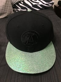 Black and green Argos hat