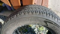 black auto tire with tire West Vancouver, V7P 3T1