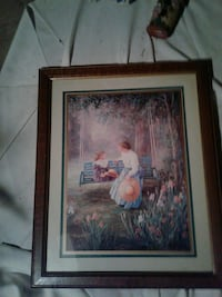 brown wooden framed painting of woman in white dress