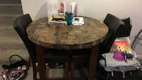 round brown wooden table with four chairs dining set 400 mi