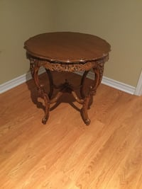 Round brown wooden side table Montréal, H9H 2N8