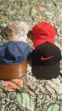 three assorted color fitted caps London, N6A 1V4