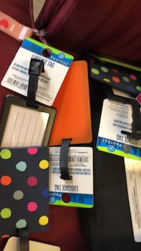 8 assorted luggage tags