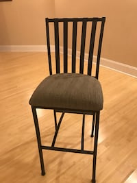 Black wood-frame padded chair