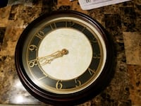 Brown battery operated wall clock Boston