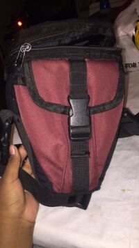 Red and black leather crossbody bag camera New York, 11237