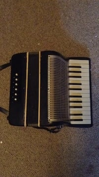 Black and gray accordian Northfield, 03276
