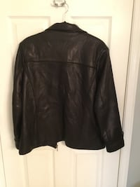 Black leather jacket with zipper. Size small, but could fit a medium. EUC Ladner, V4K