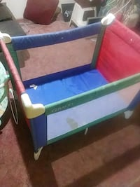 baby's blue and green travel cot