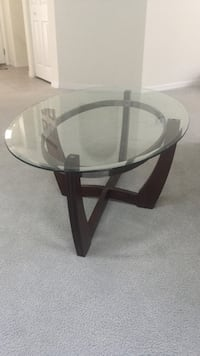 Round glass top table with black wooden base. Completely new. 50*30 inches
