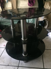 2 black and gray metal base glass top tv stand
