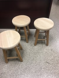3 wooden stools with removable cushions