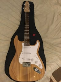 brown and white stratocaster electric guitar New York, 10461