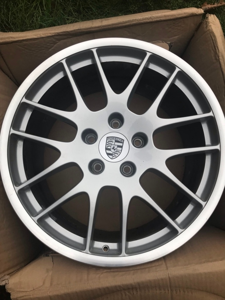 4 factory 20\u201d Porsche wheels ome