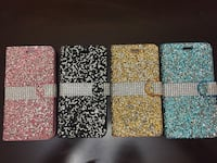 four assorted color glittered smartphone cases