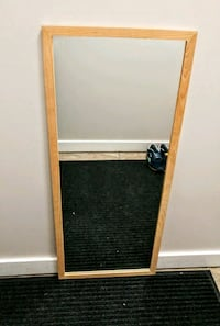 brown wooden framed wall mirror 3491 km