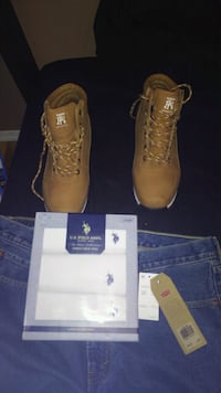 pair of brown Timberland work boots St. Louis, 63136