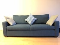 dark green 2-seat sofa. Pillows included