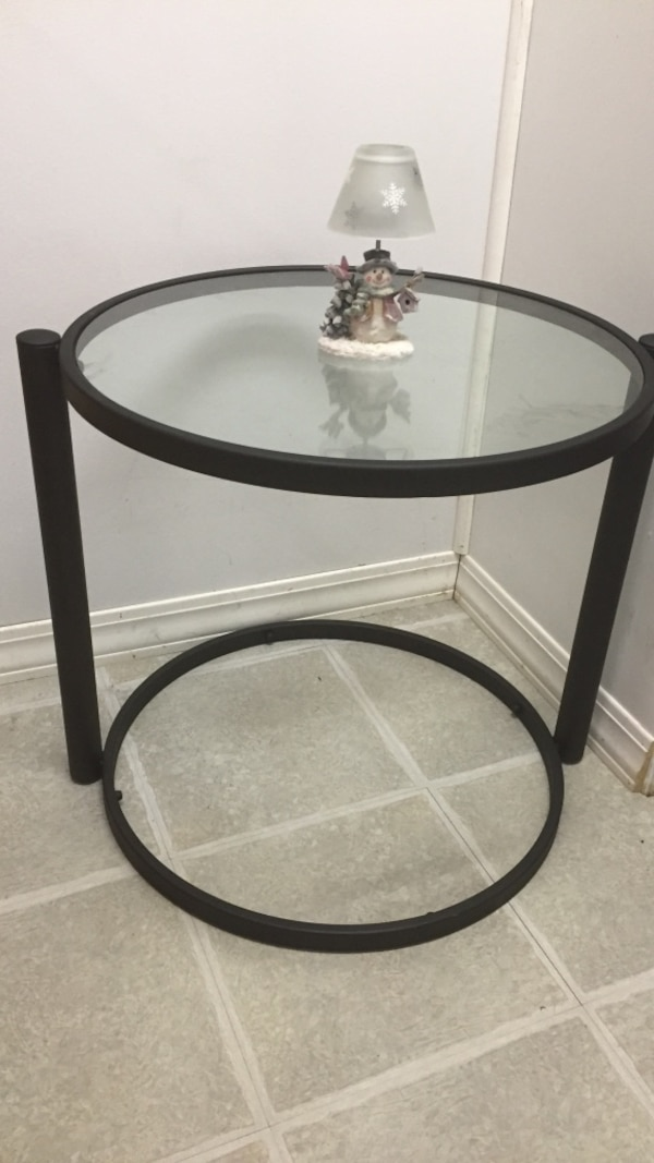 Round black metal framed glass top table