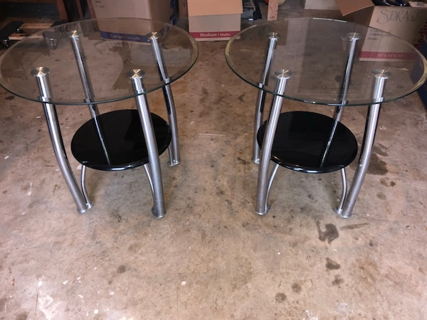 Three stainless steel base black glass top tables