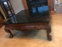Brown wooden framed marble top coffee table Stickney