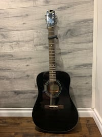 black fender acoustic guitar