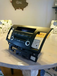 Mitsubishi Lancer stock radio/ cd and bezel. Delta, V4C 3W5