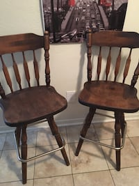 2 wood swivel bar stools  New Orleans, 70131