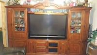 brown wooden TV hutch with flat screen television San Antonio, 78210
