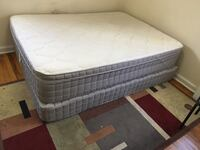 quilted white mattress and brown wooden bed frame 44 km