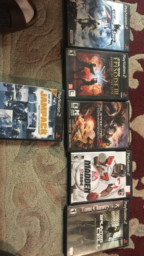 Four assorted sony ps2 game cases