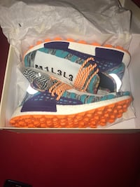 Adidas Pharell NMD Solar Hu - MEN 9.5  New York, 11233