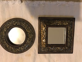 Two round and square gold framed mirrors