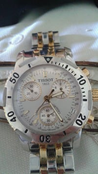 round silver-and-gold-colored Tissot chronograph w 537 km