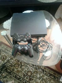 Sony PS3 slim console with two controllers 2341 mi