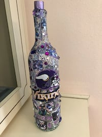Vikings bottle. Fully decorated led lighted w pale purple lights   Lady Lake, 32159