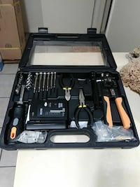 black-and-gray handheld tool set with case