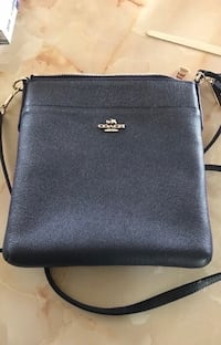 New Coach Dark blue almost black Crossgrain Leather Courier Crossbody Shoulder Purse BRAND NEW COACH LEATHER CROSSBODY PURSE  MSRP: $145.00 + SALES TAX DESCRIPTION:     * MATERIAL IS A BEAUTIFUL BLACK CROSSGRAIN LEATHER WITH LEATHER TRIM     * TOP POL Fullerton, 92831