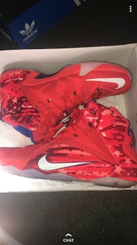 pair of red Nike basketball shoes Columbus
