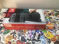 Nintendo Switch box with game cases Burnaby, V3N 2N2