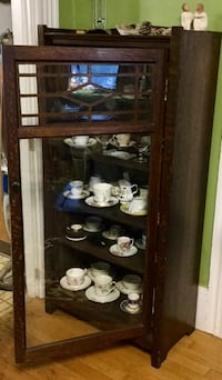 Vintage Brown wooden 4 shelf clear glass display cabinet pictures are showing discoloration but there are none