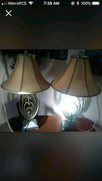 two white and brown table lamps