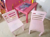 two pink wooden armless chairs