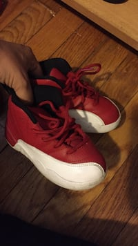 toddler's red-and-white Air Jordan 12 shoes
