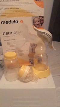 two white and yellow Medela breast pump Montreal, H3T 1J5