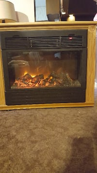 brown wooden framed electric fireplace 152 km