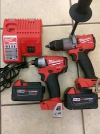 Milwaukee m18 hammer drill /impact driver w 2 battery and charger