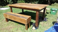 rectangular brown wooden table and bench