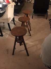 two brown wooden bar stools 217 mi