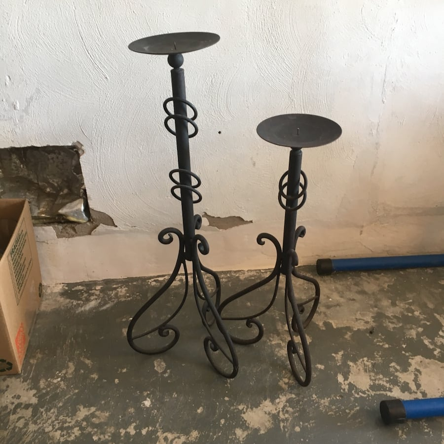 2 black metal floor candle holders